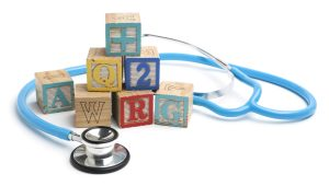 Stethoscope and wooden alphabet blocks.